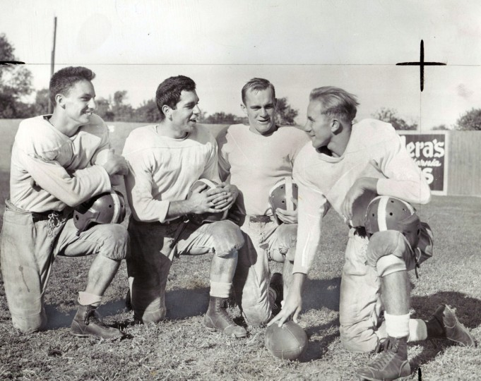 Patterson Park High School's backfield: Left to right: Len Sawicki (F.B.), Rich Travagline (L.H.), Charles Nurkicwicz (R.H.), and Gene Nos (Q.B.) are talking things over. (Baltimore Sun archives, 1947)