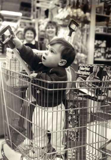 Robert, his mother Doris, and his sister Cathy Deaver Mitton shop for children of the family at Toys-R-Us, including her son Matthew, 10 months. Robert loads truck with toys. (Karl M. Ferron/Baltimore Sun)
