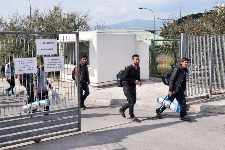 ATHENS, GREECE - OCTOBER 7: Immigrants leave Galatsi Olympic Hall to get on train and reach Greece-Macedonia border on October 7, 2015 in Athens, Greece. Greek authorities reopened the Galatsi Olympic Hall in a bid to accommodate some of the immigrants who have arrived in the country recently. About 800 people, mostly from Syria and Afghanistan, were bused to the stadium from Athen's central Victoria Square.(Photo by Milos Bicanski/Getty Images)