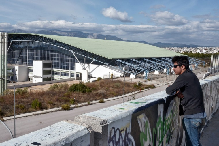 ATHENS, GREECE - OCTOBER 6: Immigrant from Afghanistan looks at Galatsi Olympic Hall on October 7, 2015 in Athens, Greece. Greek authorities reopened the Galatsi Olympic Hall in a bid to accommodate some of the immigrants who have arrived in the country recently. About 800 people, mostly from Syria and Afghanistan, were bused to the stadium from Athen's central Victoria Square. (Photo by Milos Bicanski/Getty Images)