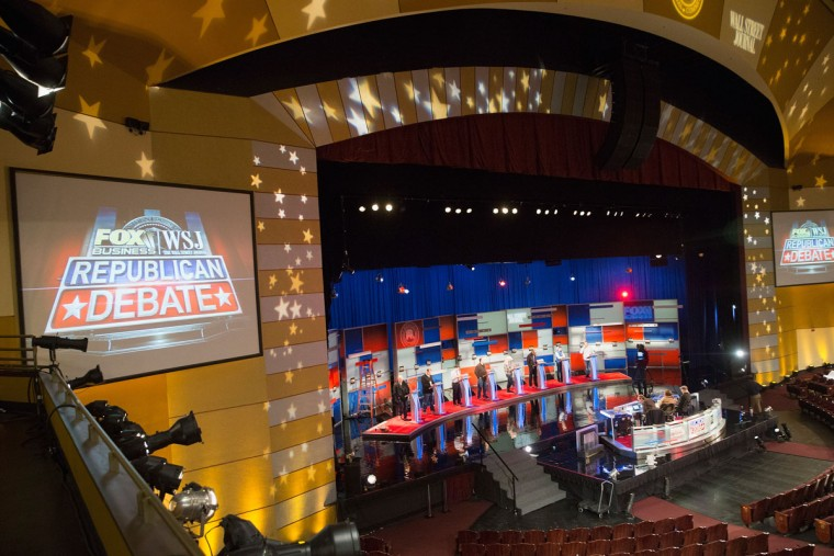 Workers test the setup at the Milwaukee Theater for the Republican presidential debate sponsored by Fox Business News and the Wall Street Journal on November 9, 2015 in Milwaukee, Wisconsin. The debate, which is scheduled for tomorrow evening, will be the third for the Republicans seeking their party's nomination for president. (Photo by Scott Olson/Getty Images)