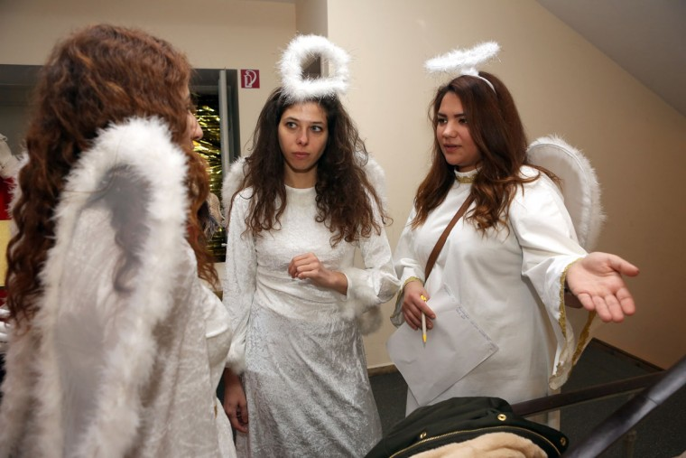 Christmas angels talk to one another at a gathering of volunteer student Santas and angels on November 28, 2015 in Berlin, Germany. (Photo by Adam Berry/Getty Images)