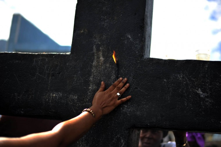 Voodoo followers take part in ceremonies honoring the Haitian voodoo spirits of Baron Samdi and Gede during Day of the Dead in the National Cemetery, in Port-au-Prince, Haiti on November 2, 2015. Voodoo believers and devotees offer candles, alcohol and food. The Day of the Dead is celebrated on the first two days of November during All Saints and All Souls Day. (Hector Retamal/Getty Images)