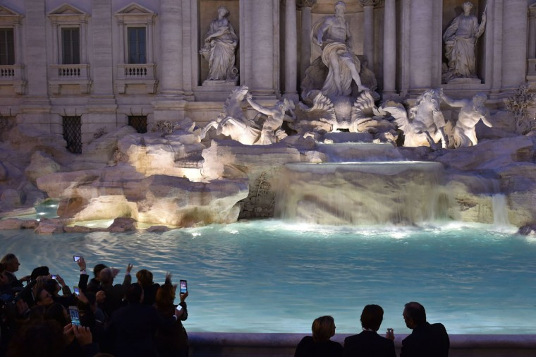 People take pictures of the restored Trevi fountain during its inauguration on November 3, 2015 in central Rome. (ALBERTO PIZZOLI/AFP/Getty Images)