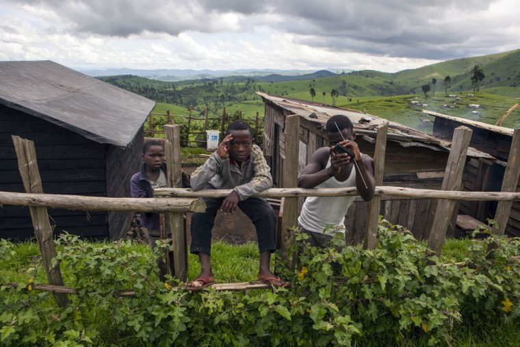 Cheese factory workers pose in Kilolirwe in the eastern territory of Masisi on November 2, 2015. Masisi in the Democratic Republic of the Congo is known for the production of cheese, a legacy started by Belgian priests in 1975. (AFP Photo/Eduardo Soteras)
