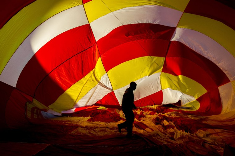 An air balloon is inflated during the International Balloon Festival at the Metropolitan Park in Leon, Guanajuato state, Mexico on November 13, 2015. (HECTOR GUERRERO/AFP/Getty Images)