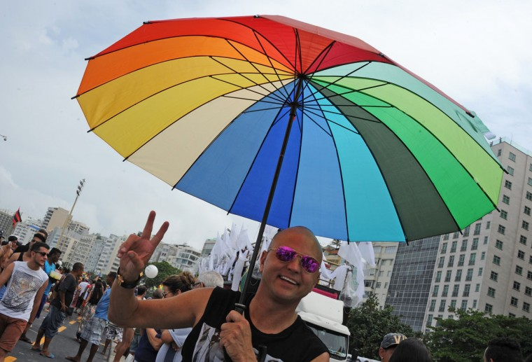 A person takes part in an LGBT Pride parade along Copacabana beach in Rio de Janeiro, Brazil, on November 15, 2015. (TASSO MARCELO/AFP/Getty Images)
