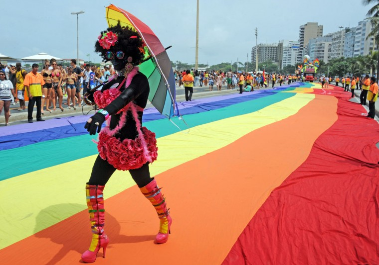 People take part in an LGBT Pride parade along Copacabana beach in Rio de Janeiro, Brazil, on November 15, 2015. (TASSO MARCELO/AFP/Getty)