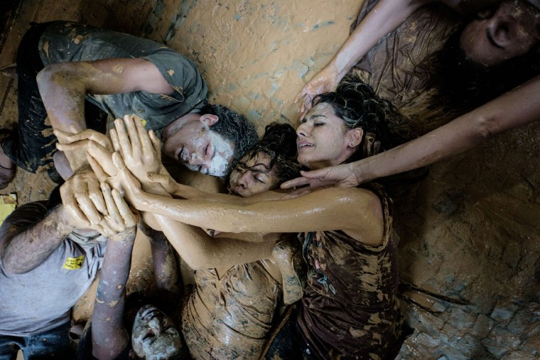 Protesters perform in front of Brazilian mining company Vale headquarters in Rio de Janeiro, Brazil, on November 16, 2015. The bursting of two dams at a mine operated by Brazilian company Samarco - equally owned by Vale and Australian BHP Billiton- unleashed torrents of waste that flattened a village in Minas Gerais State on November 5 killing ten people. (YASUYOSHI CHIBA/AFP/Getty Images)