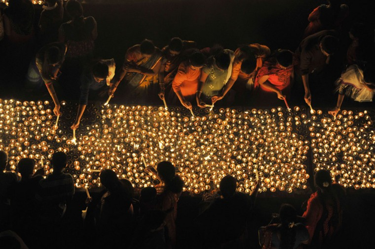 Indian Hindu devotees perform a ritual by lighting diyas - earthen lamps - on the occasion of Karthika month in Hyderabad on November 25, 2015. (NOAH SEELAM/AFP/Getty Images)