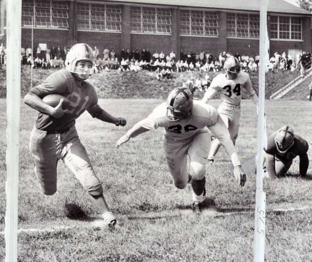 Mo Cambridge (No. 21) of Loyola makes gain around right and before being tackled by Leonard Maloney (No. 38) of St. Joe. (William Klender/Baltimore Sun, 1956)