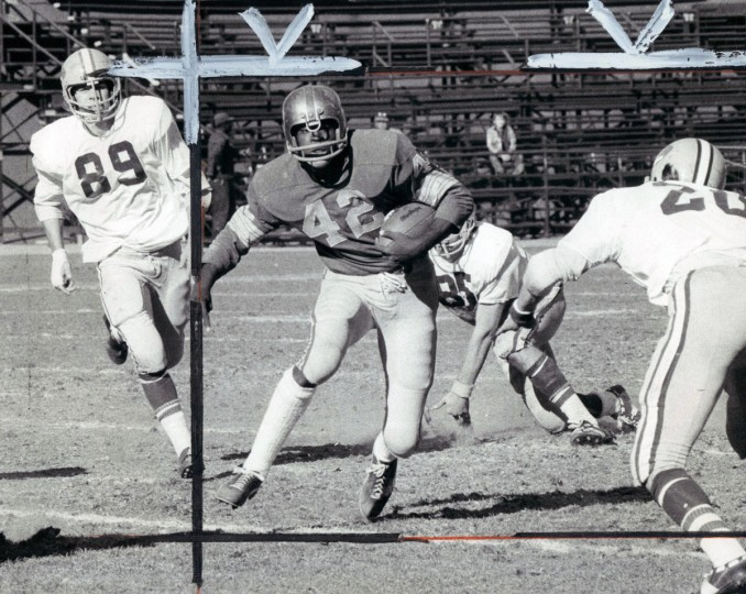 Calvert Hall's Vince Kinney eludes Loyola defender for 10-yards in 14-6 Card win. (George H. Cook/Baltimore Sun, 1973)