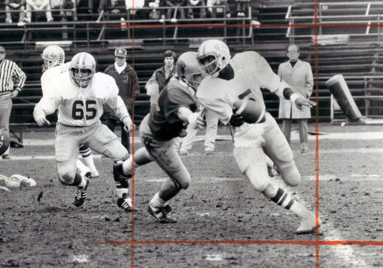 Loyola quarterback Bernie Bowers eludes Calvert Hall tackle for second-quarter gain. (Joseph A. DiPaola/Baltimore Sun, 1977)