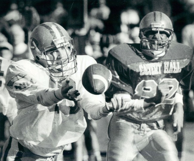 Loyola's Aaron Reinhart dives for a long pass and Calvert Hall's Roland Brown follows. (Baltimore Sun archives, 1988)