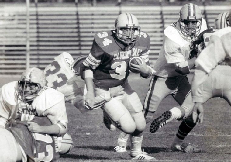 Calvert Hall's Richard Shure picks up a few yards before Loyola's Tim Welsh (33) slows him down. Shure also caught a TD pass for the Cardinals. (William H. Mortimer/Baltimore Sun, 1981)