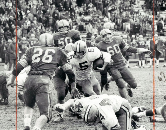 Loyola quarterback Dan Dullea plunges for five-yard gain in second period. (Joseph A. DiPaola/Baltimore Sun, 1971)