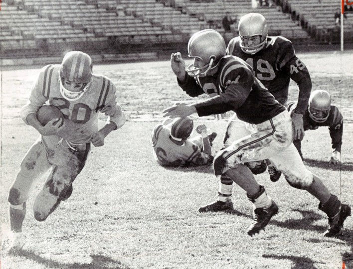 Ken Harms turns end for good gain for Calvert Hall against Loyola. (Paul Hutchins/Baltimore Sun, 1964)