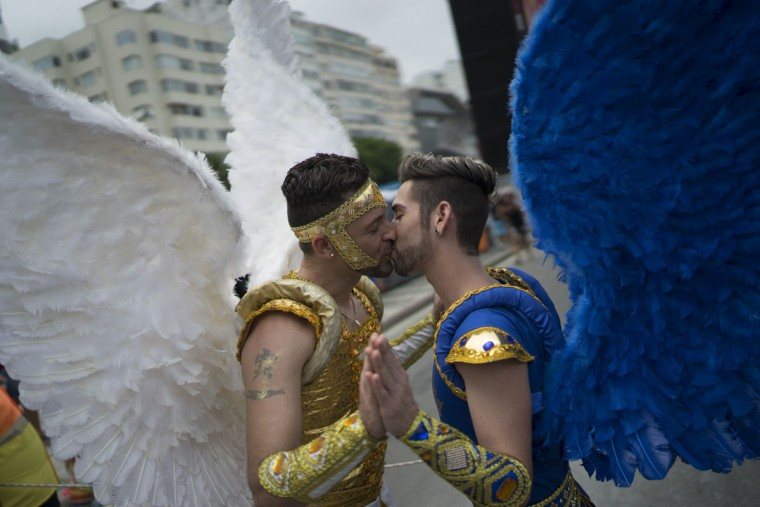 Two men kiss during the Gay Pride Parade at Copacabana beach, in Rio de Janeiro, Brazil, Sunday, Nov. 15, 2015. (AP Photo/Leo Correa)