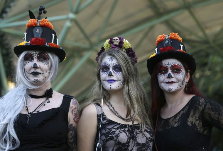 Women dressed in costumes celebrate the Day of the Dead, Monday, Nov. 2, 2015, in Fort Lauderdale, Fla. The event honors Mexican traditions where the dead are honored by their loved ones. (Alan Diaz/AP photo)