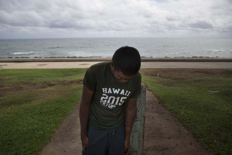Foster Waynewright, 28-year-old homeless man, leans on a post while resting in Kakaako Waterfront Park in Honolulu. Waynewright lives in a minivan with his grandmother. Homelessness in Hawaii has grown in recent years, leaving the state with 487 homeless per 100,000 people, the nation's highest rate per capita, ahead of New York and Nevada, according to federal statistics. (AP Photo/Jae C. Hong)
