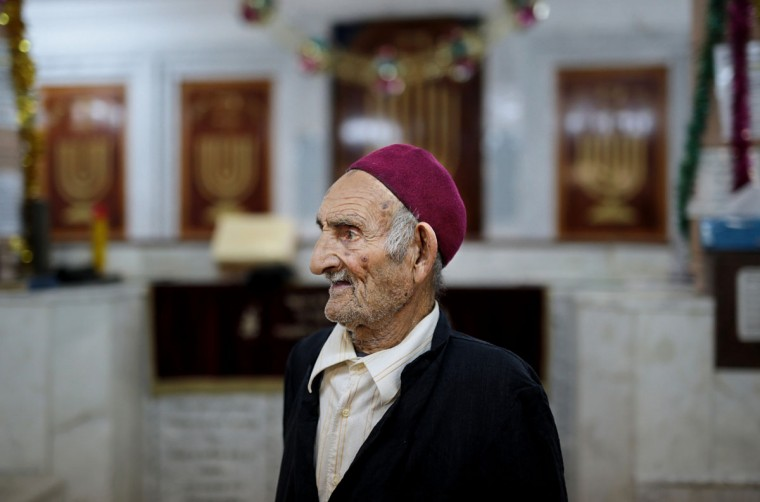 A caretaker of the Synagogue of the Kohanim of Djirt, pauses before prayers, at Hara Kbira, the main Jewish neighborhood on the Island of Djerba, southern Tunisia. The Jewish community in the resort island of Djerba traces its roots all the way back to Babylonian exile of 586 B.C., and is one of the few communities of its kind to have survived the turmoil around the creation of Israel, when more than 800,000 Jews across the Arab world either emigrated or were driven from their homes. (AP Photo/Mosa'ab Elshamy)