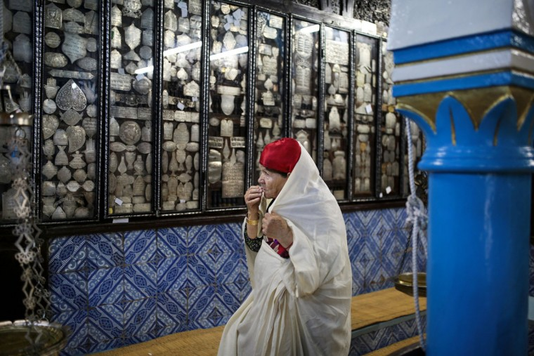 A Tunisian Jewish woman prays in La Ghriba, the oldest synagogue in Africa, on the Island of Djerba, southern Tunisia. The Jewish community in the resort island of Djerba traces its roots all the way back to Babylonian exile of 586 B.C., and is one of the few communities of its kind to have survived the turmoil around the creation of Israel, when more than 800,000 Jews across the Arab world either emigrated or were driven from their homes. (AP Photo/Mosa'ab Elshamy)