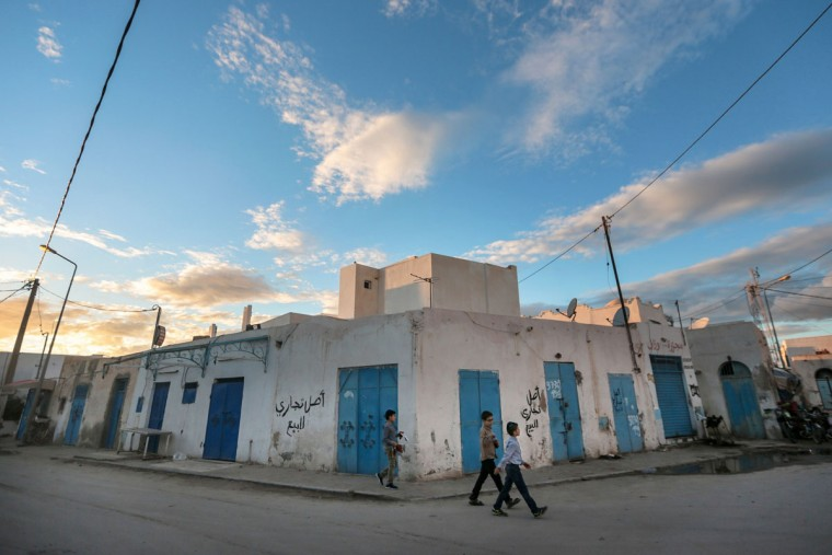 Boys walk past closed shops on the beginning of Shabbath, after sunset, at Hara Kbira, the main Jewish neighborhood in the Island of Djerba, southern Tunisia. The Jewish community on the resort island of Djerba traces its roots all the way back to Babylonian exile of 586 B.C., and is one of the few communities of its kind to have survived the turmoil around the creation of Israel, when more than 800,000 Jews across the Arab world either emigrated or were driven from their homes. (AP Photo/Mosa'ab Elshamy)
