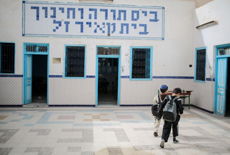 Boys walk inside a Talmudic school at Hara Kbira, the main Jewish neighborhood on the Island of Djerba, southern Tunisia. When school lets out, the streets around the ancient synagogue on this Tunisian island fill with rambunctious boys wearing Jewish kippahs and girls in long skirts, shouting to each other in Hebrew, Arabic and French. (AP Photo/Mosa'ab Elshamy)
