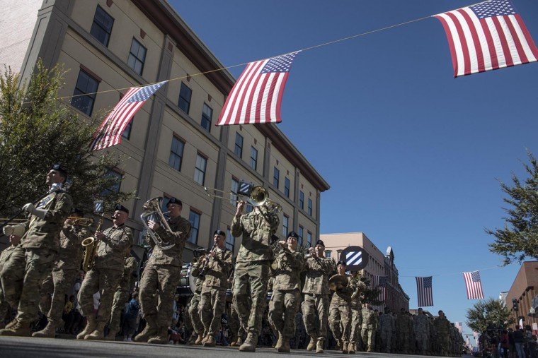Members of the Third Infantry Division march down Broughton Street during the Veteran's Day Parade in Savannah, Ga., Wednesday, Nov. 11, 2015. (Josh Galemore/Savannah Morning News via AP)