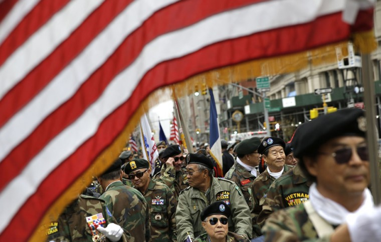 Korean Vietnam War veterans prepare to march in the annual Veteran's Day parade in New York, Wednesday, Nov. 11, 2015. (AP Photo/Seth Wenig)