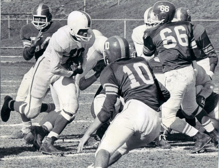 Charley Pittman, Edmondson's fullback, rips through Forest Park line for nice gain at Kirk Field. (Paul Hutchins/Baltimore Sun, 1964)