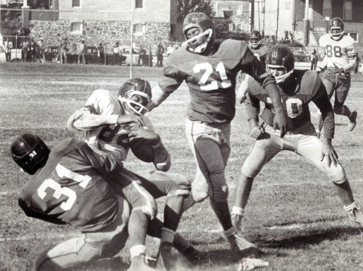 Ernie Bell is dropped by Edmondson's Frank Ravelle as Carver back gained yardage. (William Mortimer/Baltimore Sun, 1961)
