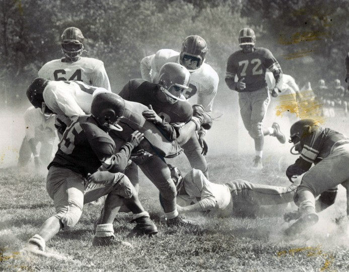 Edmondson's Maurie Blow goes through the line for five yards. (William Klender/Baltimore Sun, 1959)