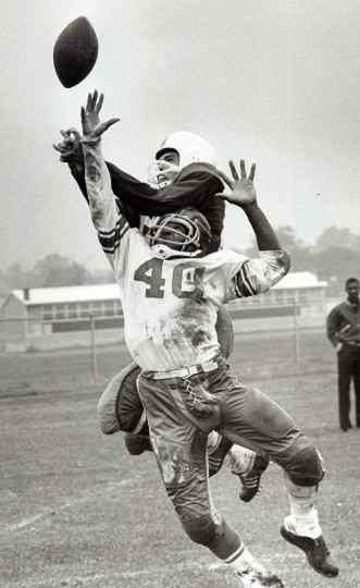 Carver's Howard Stevenson breaks up a pass intended for Edmondson's Bernie Smith. (Paul Hutchins/Baltimore Sun, 1964)