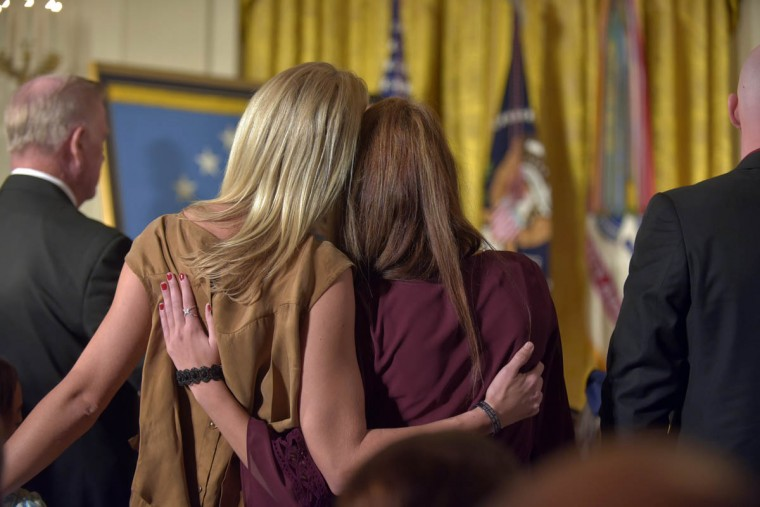 Family members of those killed during an attack in which Retired US Army Captain Florent A. Groberg's actions are honored with the Medal of Honor, stand during a ceremony where US President Barack Obama awarded him the Medal of Honor in the East Room of the White House. He is the tenth living recipient to be awarded the Medal of Honor for actions in Afghanistan. (Algerina Perna, Baltimore Sun)