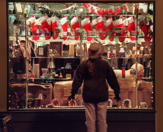 Rebecca Clary of Canton peers into the display window of The Big Iguana on Thames St as people window shop during the holiday season Sun., Dec. 13, 1998. Though many think of it as a dated kind of shopping, some say that window shopping is alive and well. (Baltimore Sun/Karl Merton Ferron)