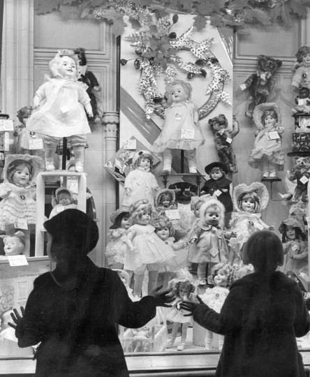 Two young girls take in a display of dolls in a downtown department store. (A. Aubrey Bodine/Balitmore Sun, 1938)