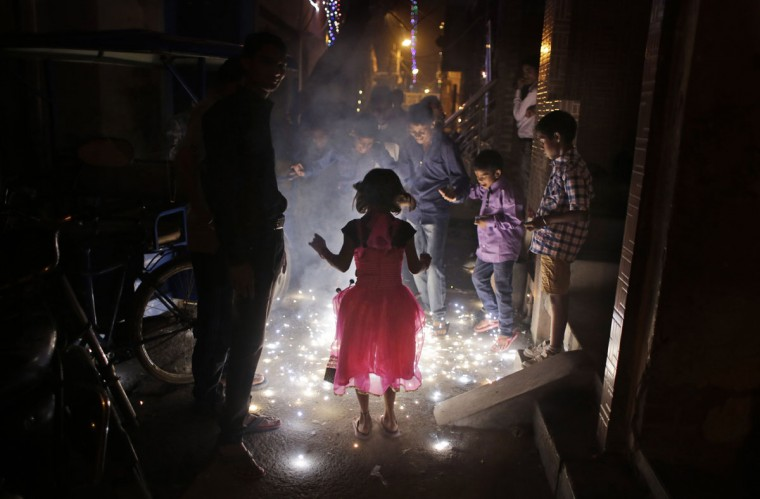 Indian children play with firecrackers during Diwali celebrations in New Delhi, India, Wednesday, Nov. 11, 2015. (AP Photo/Altaf Qadri)