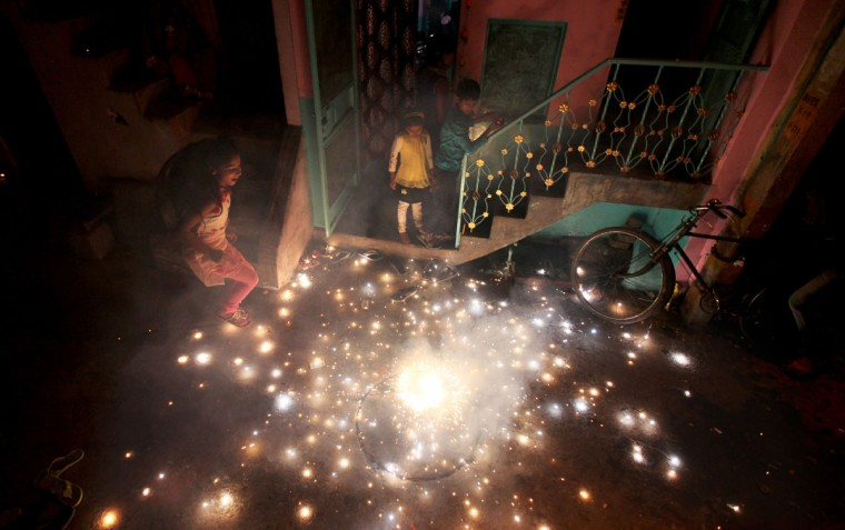 Indian children play with firecrackers during Diwali celebrations in New Delhi, India, Wednesday, Nov. 11, 2015. Diwali, the festival of lights, is one of Hinduism's most important festivals dedicated to the worship of Lakshmi, the Hindu goddess of wealth. (AP Photo/Altaf Qadri)