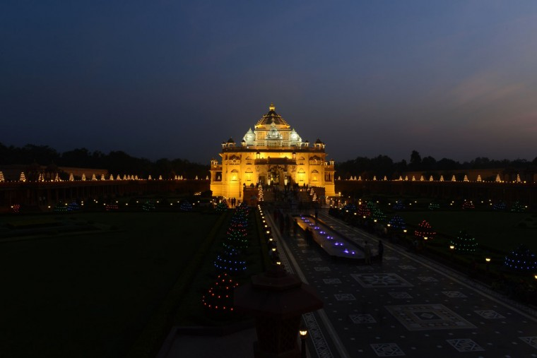 Visitors throng Akshardham temple, illuminated with some 10,000 Diyas or oil-lit lamps on the eve of Diwali in Gandhinagar on November 10, 2015. Lighting of the lamps started November 10 and will last until November 16. (SAM PANTHAKY/AFP/Getty Images)