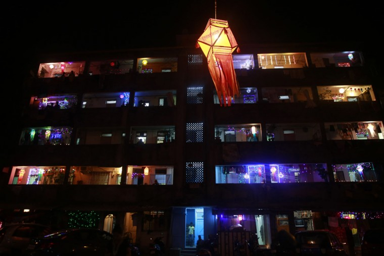A tenement block housing mostly fishermen families is illuminated with lights during Diwali in Mumbai India, Wednesday, Nov. 11, 2015. Diwali, the festival of lights, is one of Hinduism's most important festivals dedicated to the worship of Lakshmi, the Hindu goddess of wealth. (AP Photo/Rafiq Maqbool)