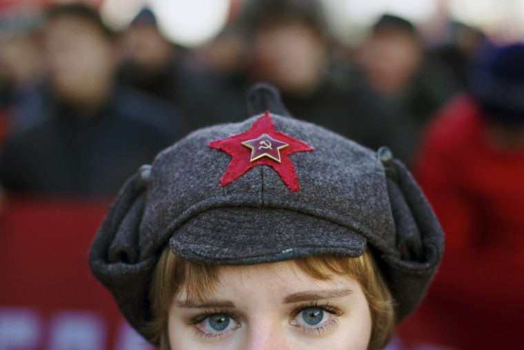 A girl wears a hat with a Soviet-era insignia as she takes part in a Communist demonstration marking the 98th anniversary of the Bolshevik revolution in Moscow, Russia, Saturday, Nov. 7, 2015. For decades Nov. 7 used to be a holiday celebrating the 1917 Bolshevik Revolution and which is no longer a public holiday in Russia. (AP Photo/Ivan Sekretarev)