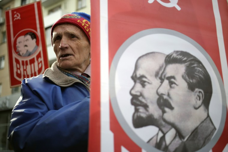 A man holds a portrait of Soviet Union founder Vladimir Lenin and Soviet leader Joseph Stalin during a rally to mark the 98th anniversary of Russia's Bolshevik Revolution in Crimean city of Simferopol on November 7, 2015. (Max Vetrov/AFP-Getty Images)