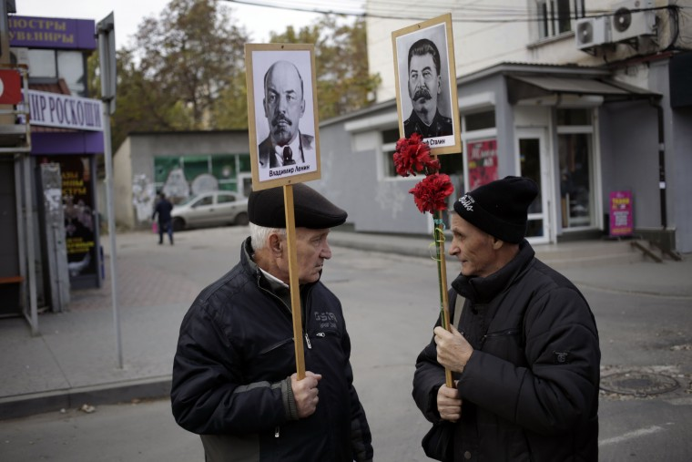 Men hold portraits of Soviet Union founder Vladimir Lenin and Soviet leader Joseph Stalin during a rally to mark the 98th anniversary of Russia's Bolshevik Revolution in Crimean city of Simferopol on November 7, 2015. (Max Vetrov/AFP-Getty Images)