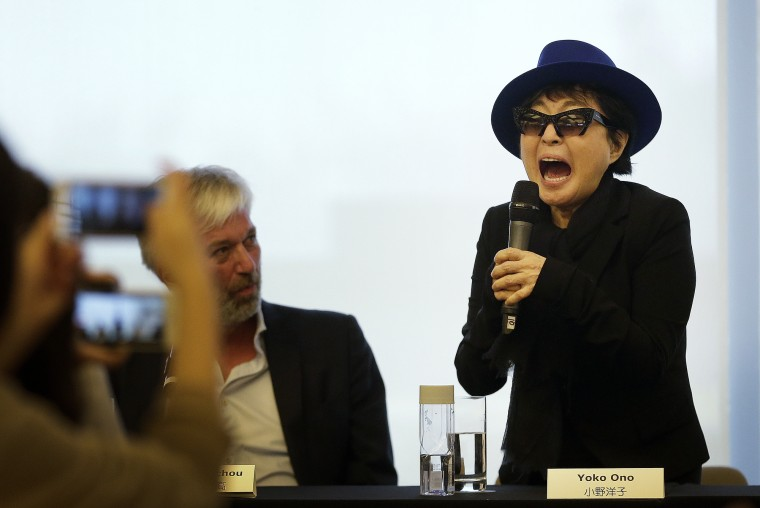 Yoko Ono performs a shout during a press conference before the opening ceremony of her exhibition held at the 798 art district in Beijing, China, Saturday, Nov. 14, 2015. (AP Photo/Andy Wong)