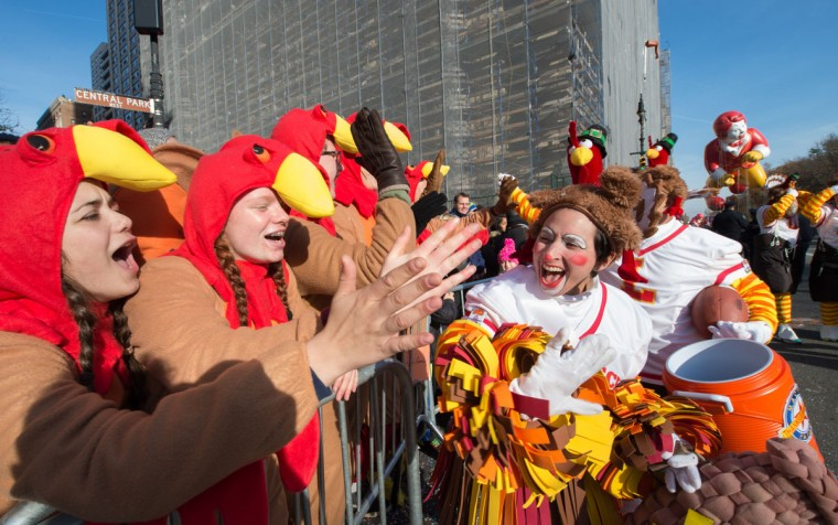Spectators dressed as turkeys cheer during the Macy's Thanksgiving Day Parade, Thursday, Nov. 26, 2015 in New York. (AP Photo/Bryan R. Smith)