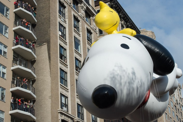 The balloon Snoopy is moved down Central Park West during the Macy's Thanksgiving Day Parade, Thursday, Nov. 26, 2015 in New York. (AP Photo/Bryan R. Smith)