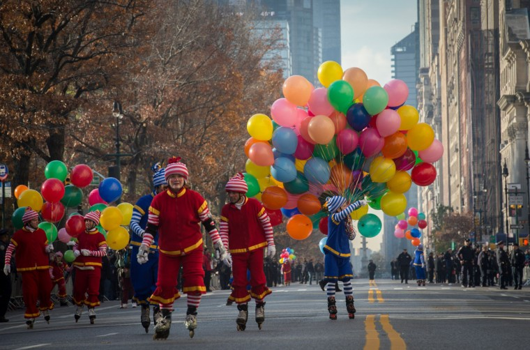 Clowns skate up Central Park West during the Macy's Thanksgiving Day Parade, Thursday, Nov. 26, 2015 in New York. (AP Photo/Bryan R. Smith)