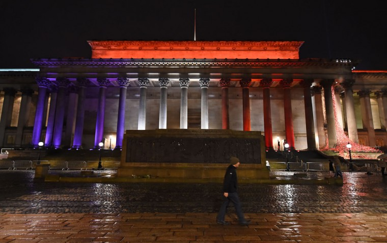 Liverpool's St George's Hall is illuminated in blue, white and red lights, resembling the colors of the French national flag, in Liverpool, north west England on November 14, 2015, as Britons express their solidarity with France following a spate of coordinated attacks that left 129 dead in Paris on November 13. (PAUL ELLIS/AFP/Getty Images)