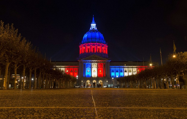 San Francisco's City Hall is illuminated in blue, white and red in San Francisco, California on November 14, 2015, one day after the Paris terrorist attacks. (Josh Edelson/AFP/Getty Images)